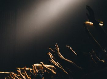 Hands lifted in worship.